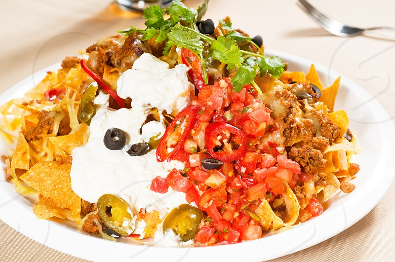 fresh nachos and vegetable salad with meat chili con carne  tipycal mexican food photo