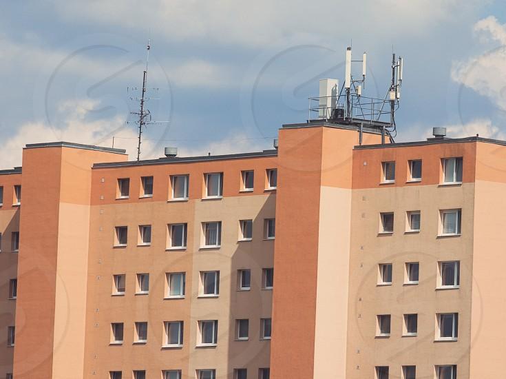 Renovated Orange Tall Residential Panel Building Closeup photo