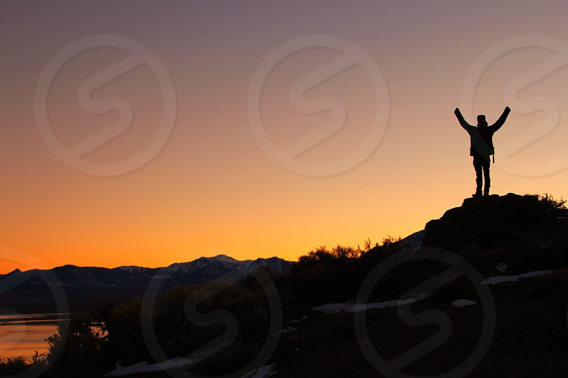 raising arms in the evening photo