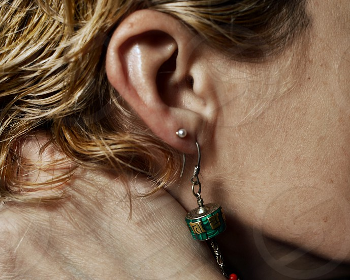 Part of a woman's face with an earring photo