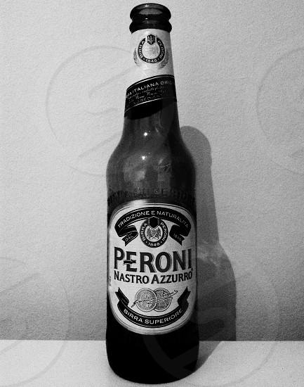 peroni nastro azzurro bottle in grayscale photograph photo