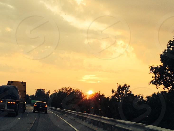 black SUV on top of gray top road under orange sky photo