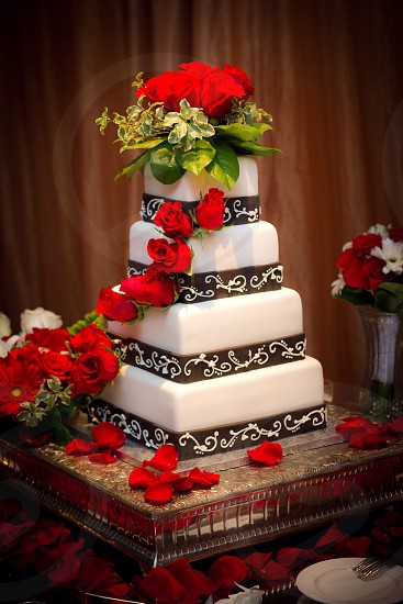 white cake with red rose  photo
