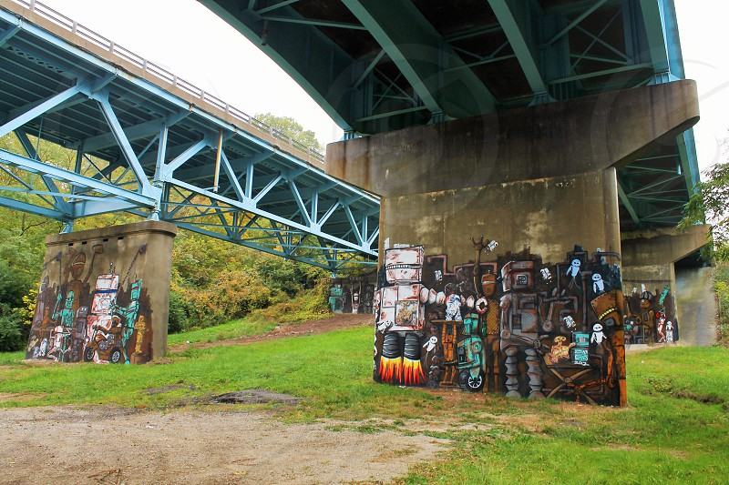 robot graffiti of concrete bridge tower photo
