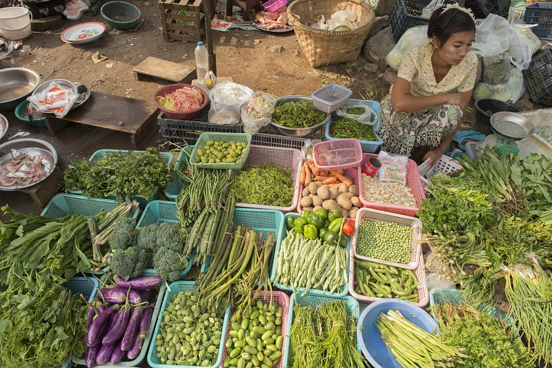 a Street fegetable and Food market in the City of Mandalay in Myanmar in Southeastasia. photo