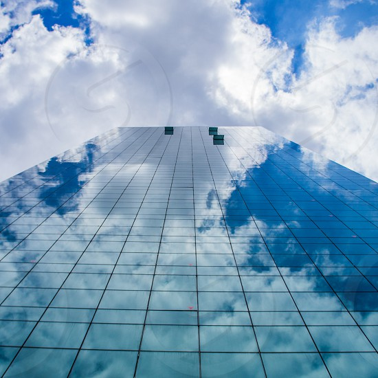 worms eye view photography of concrete building under cloudy sky photo