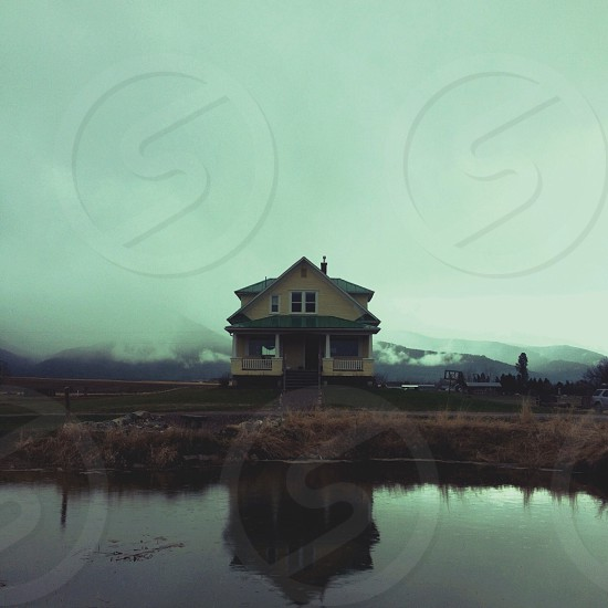 house in front of lake  photo