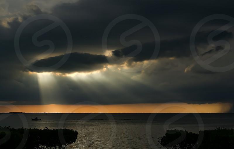 Sunsetting rays of light Key Largo Florida Florida Keys Mother Nature water heavenly photo