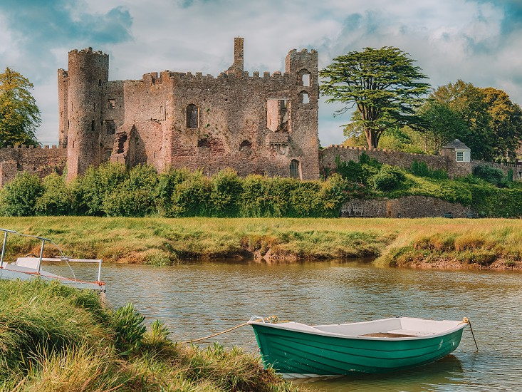 Magical Laugharne Castle Carmarthenshire Wales. This magnificent medieval castle was built in the 13th century by the de Brian family probable atop an earlier Norman castle. Dylan Thomas put pen to paper in the summer house within the castle grounds. photo