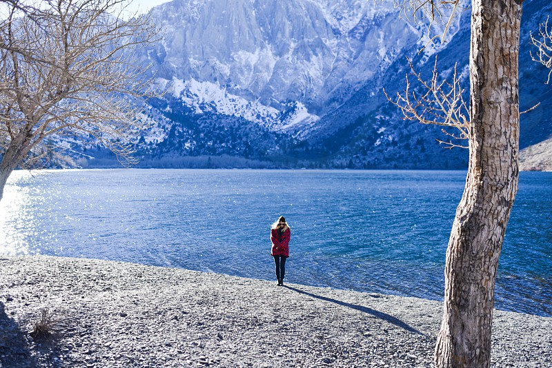 alone girl cold winter lake photo