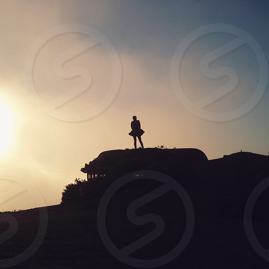 woman in a mountain silhouette  photo