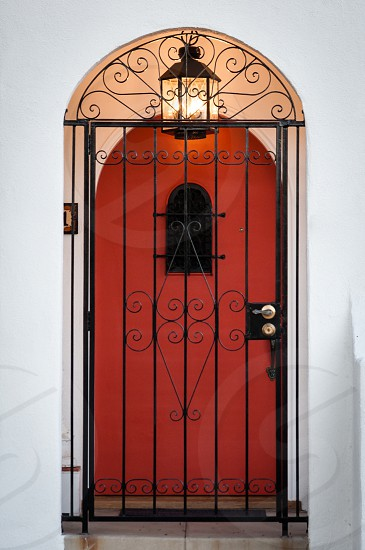 red door behind metal gate photo