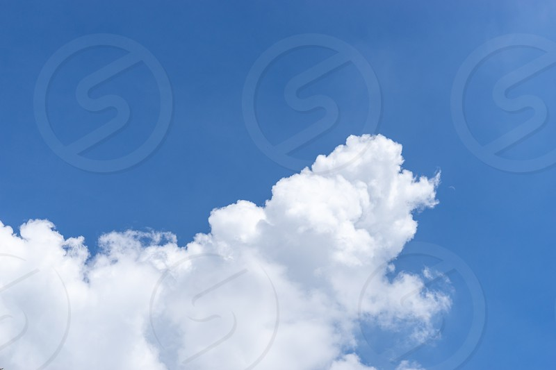 cloudscape dramatic withe cloud  on blue sky copy space photo