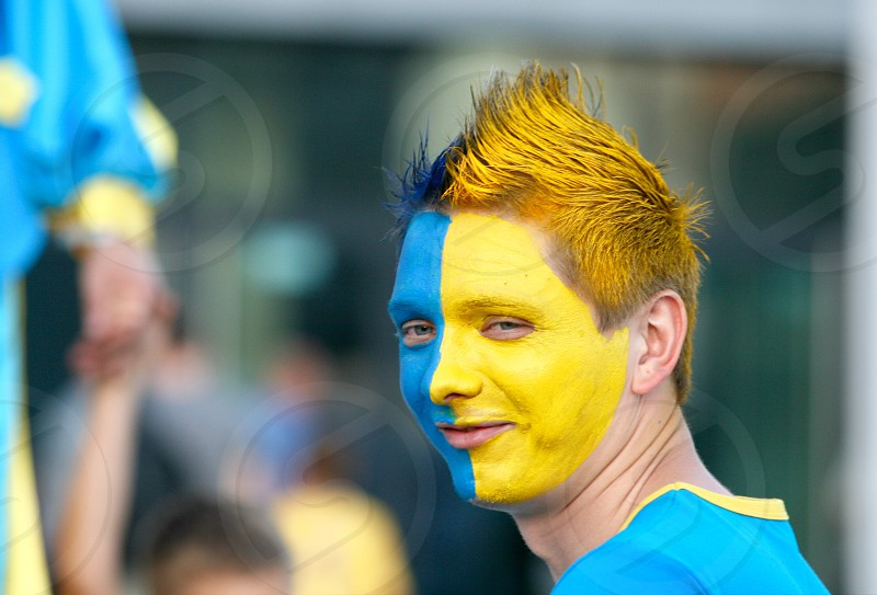 Fan football fan millennial activity adult face haircut yellow and blue man football  photo
