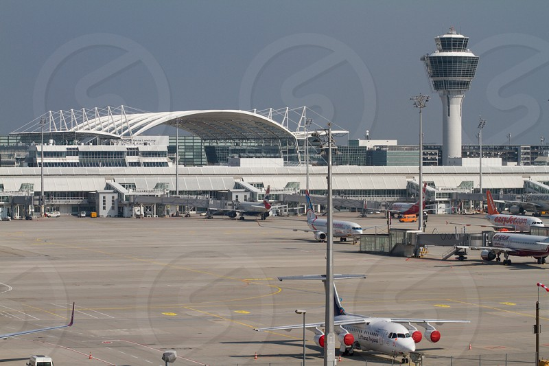 white airport with runway and airplanes photo
