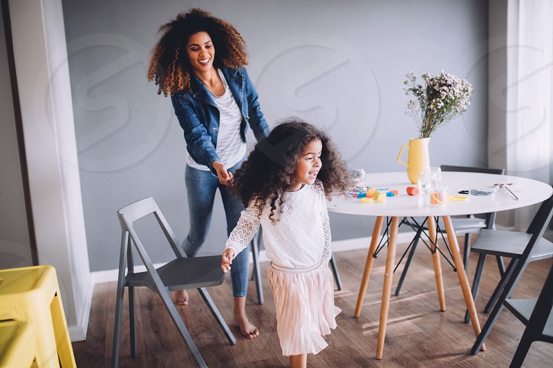 Mother and Daughter having fun at home. photo