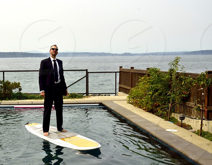 Wearing a suit while paddle boarding  photo