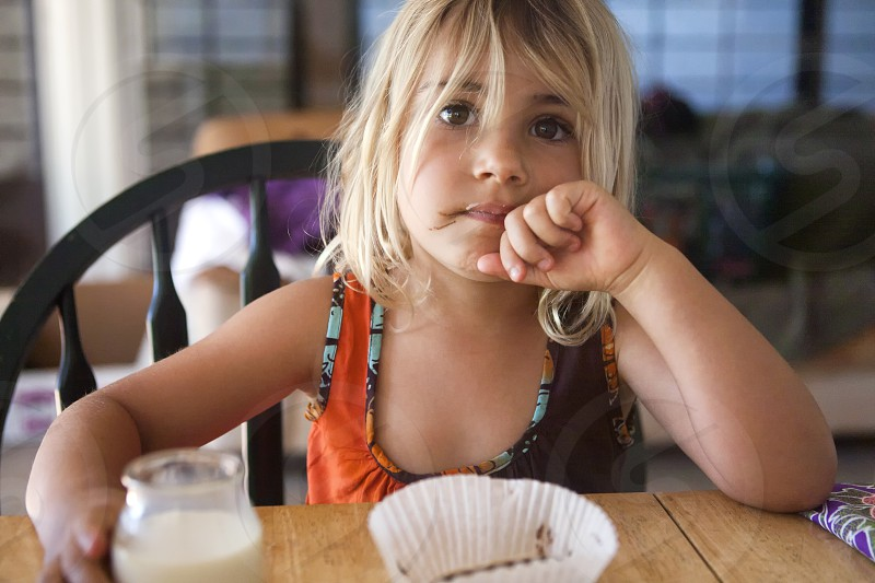 5 year old toddler at the table photo