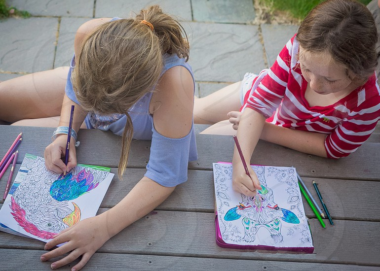 Coloring outside on front porch  photo