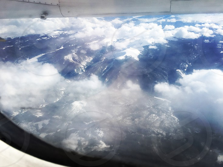 Travel; airplane; flying; flight; mountains; snow; plane; fly photo