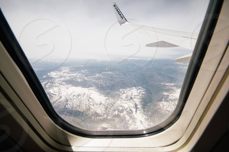 airplane wing over snowy area photo