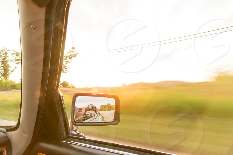 A road trip in a convertible in the summertime with sun flare photo