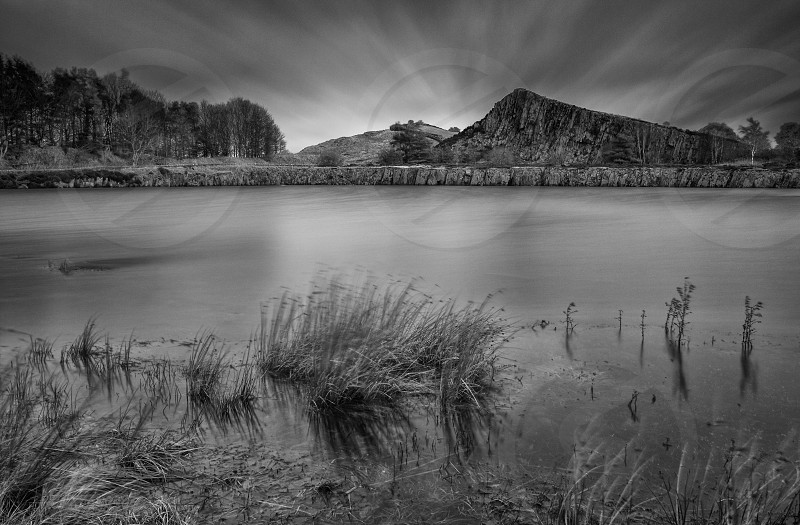 Long exposure revealing movement in the clouds above Cawfields Quarry and lake on Hadrian's Wall. Northumberland Northumberland National Park  England UK. photo