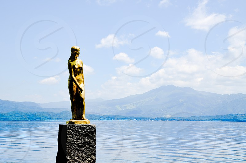 Statue of Tatsuko in Lake Tazawa Akita Japan photo