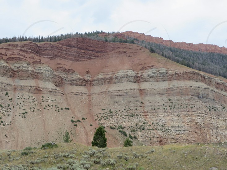 Red Hills. Looks like a crying mountain.  photo
