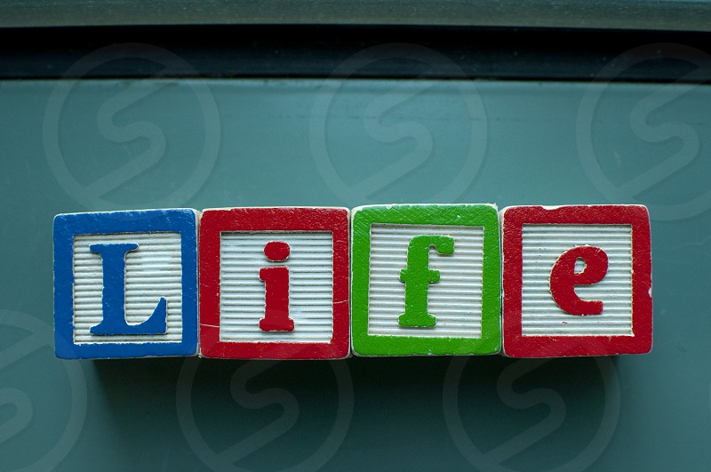 Life written on colorful toy blocks photo