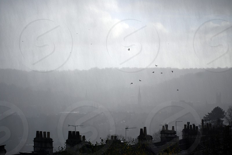 View over rooftops on a rainy day. photo