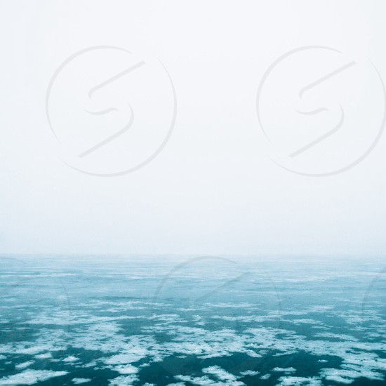 sea with snow mist view photo