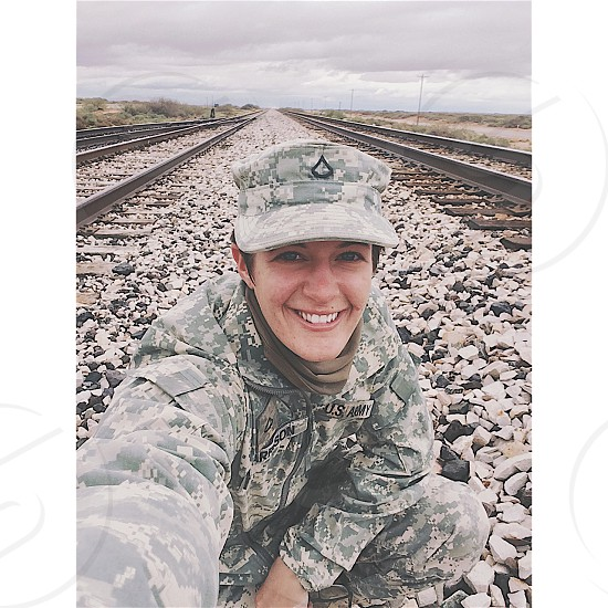photography of woman wearing grey camouflage army suit photo