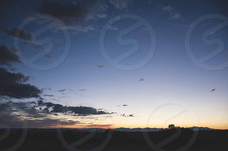 Sunset; Santa Fe; New Mexico; mountains; silhouette; stars  photo