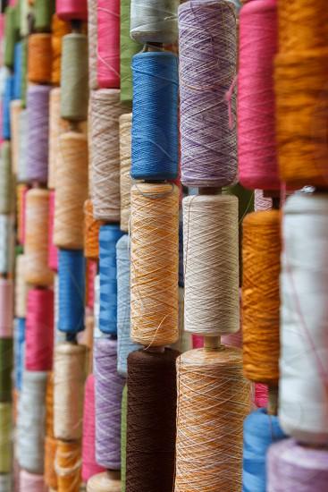 Bobbins with multicolor thread. photo