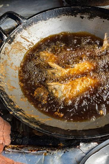 Street food - fried mackerel photo