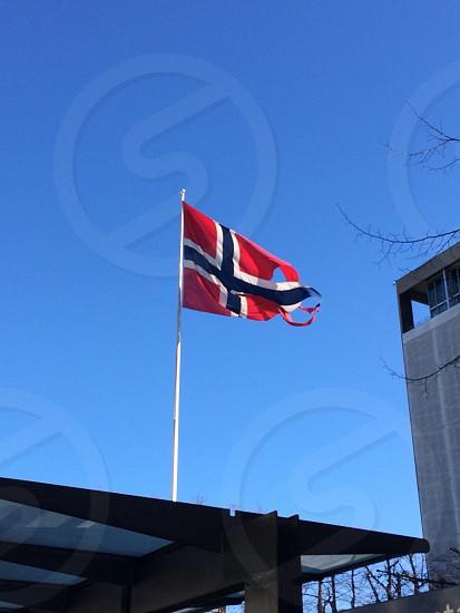 Norwegian Flag waving in Oslo.  photo