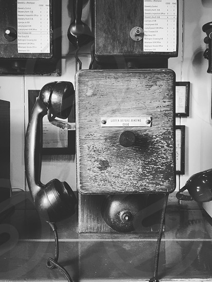 grayscale photo of rotary phone photo
