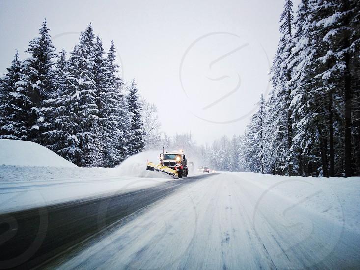 Snow plow on wintery highway photo