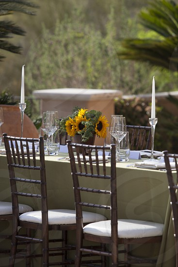 celebrate celebration dinner party party candles served waiter chairs table al fresco dining flowers wine glass  photo