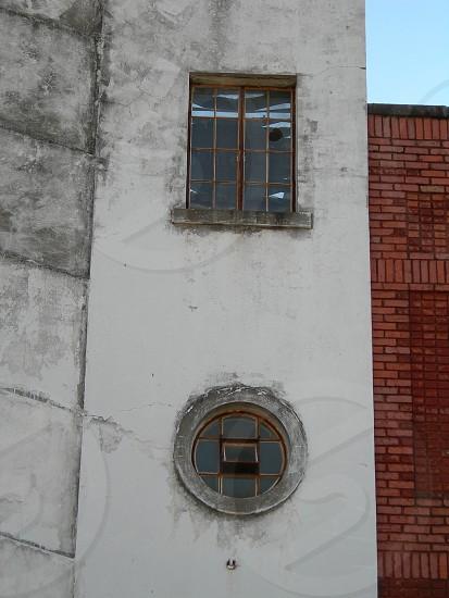 Broken windows in abandoned building. photo