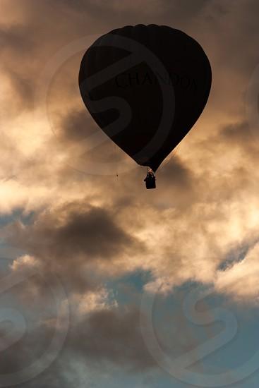 Hot air balloon silhouette with sunrise in Australia photo
