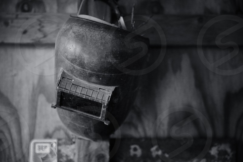 welder's hat grayscale on wooden surface photo