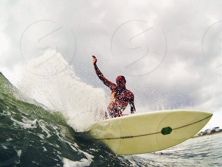 person surfing waves photo