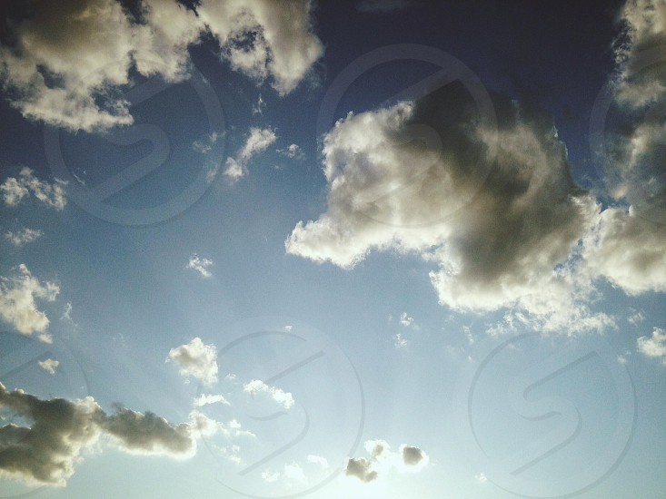 view of blue sky and white clouds photo