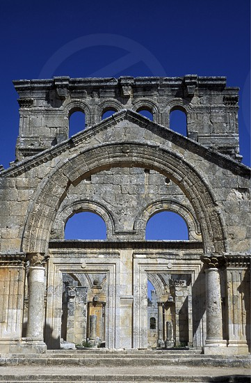 the ruins of the Basilica of Deir Samaan or St Simeon naer the city of Aleppo in Syria in the middle east photo