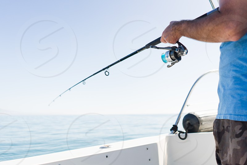 fish fishing rod sea ocean water blue fisherman photo