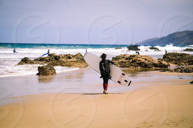 Surfing surfers nature real people sport windy  photo