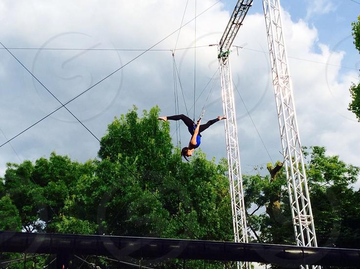 Trapeze flying split photo