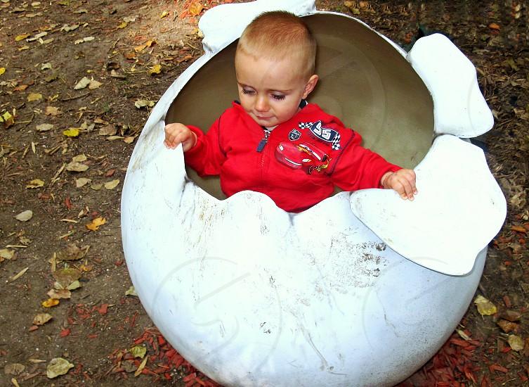 little boy in a giant egg photo
